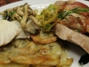 Pan seared halibut with wild mushrooms, truffled potato galette, pancetta wrapped pork tenderloin