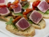Tuna, Black Olive Tapenade, Arugula, Roasted Red Pepper Crostini