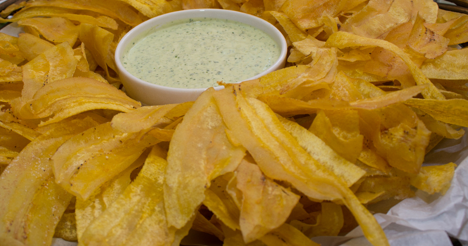 Plantain chips with cilantro dipping sauce