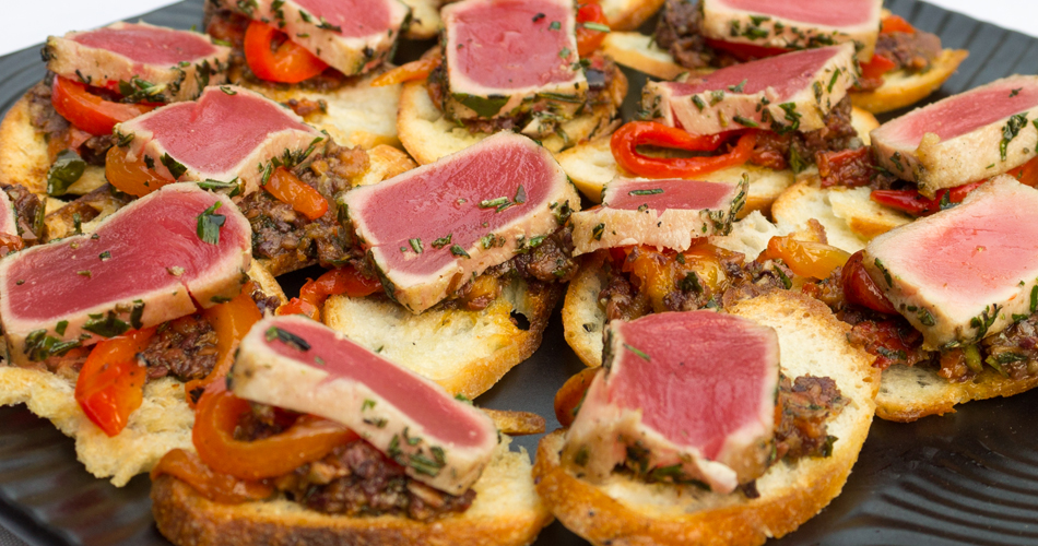 Seared tuna with black olive tapenade and roasted red bell pepper